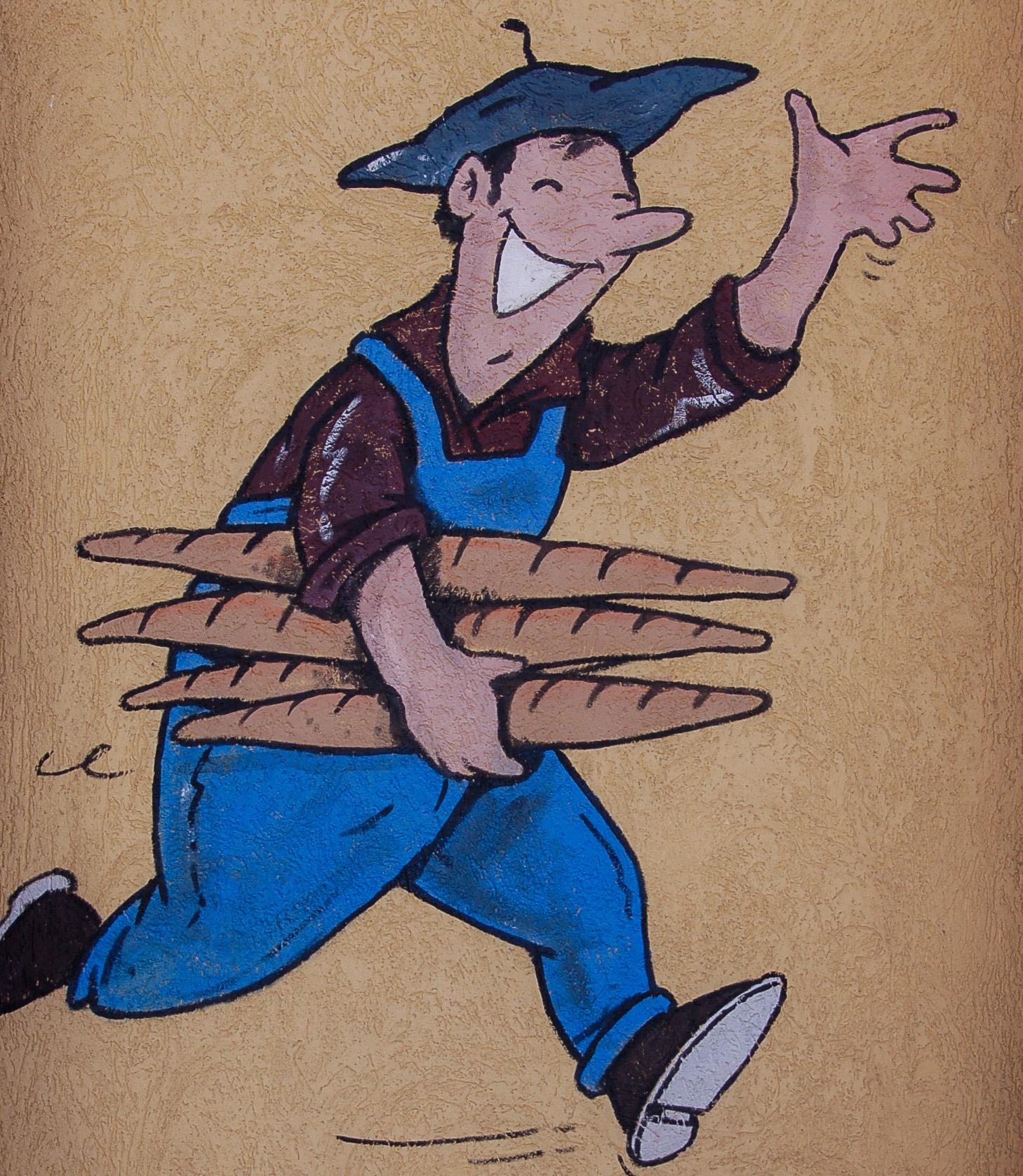 Bäcker mit Baguettes im französischen Elsass
