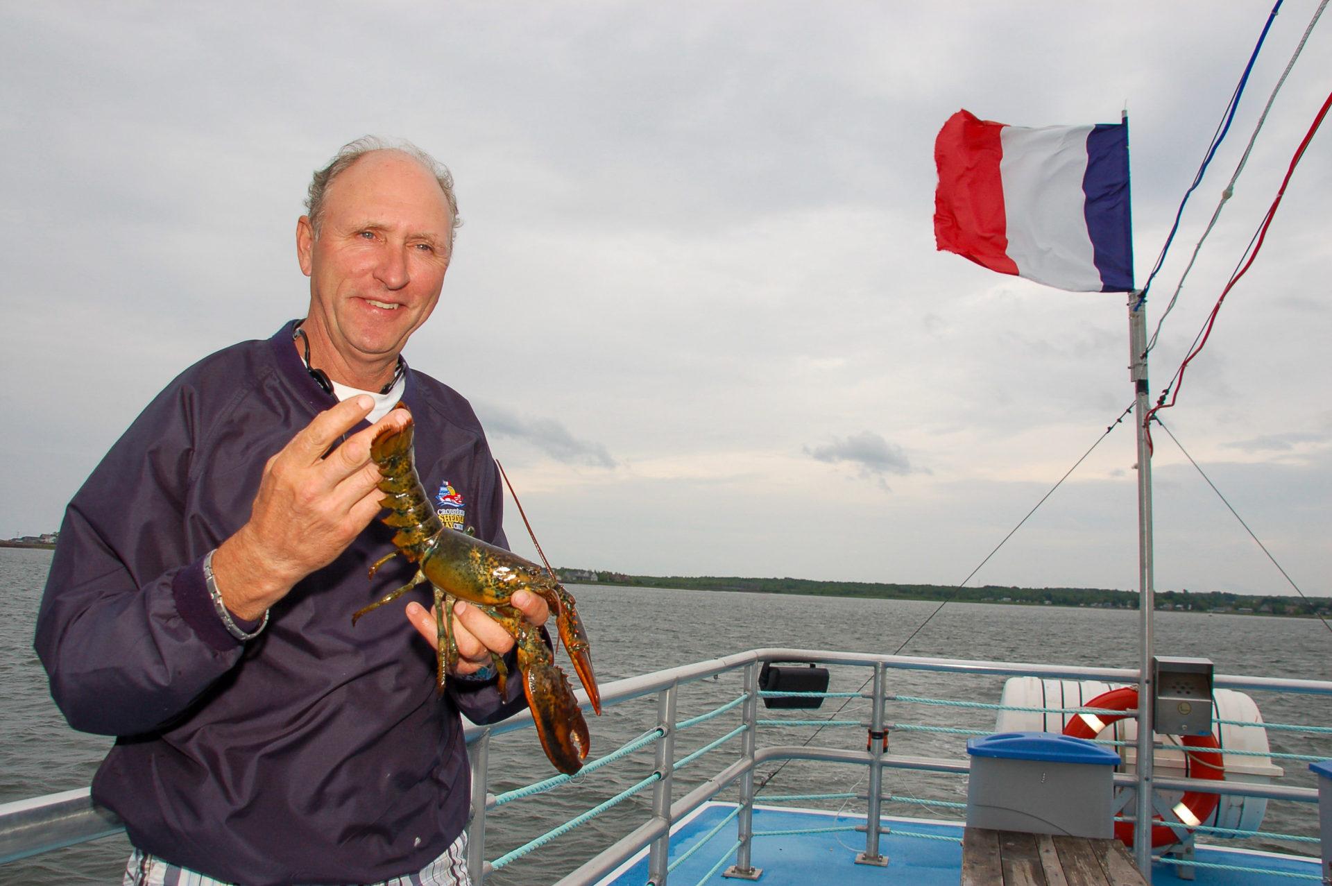 Fischer mit Hummer und französischer Falgge in New Brunswick